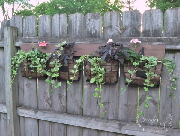 Idea for a hang on the farmhouse fence planter for geraniums and trailing vines from Jennifer Rizzo