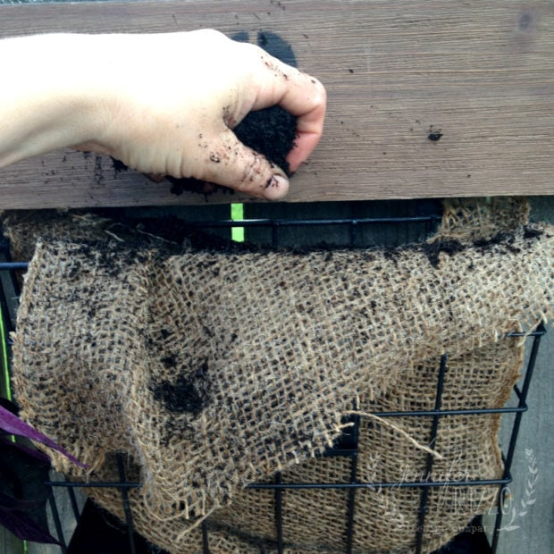 Add dirt to your DIY fence planter at Jennifer Rizzo.com