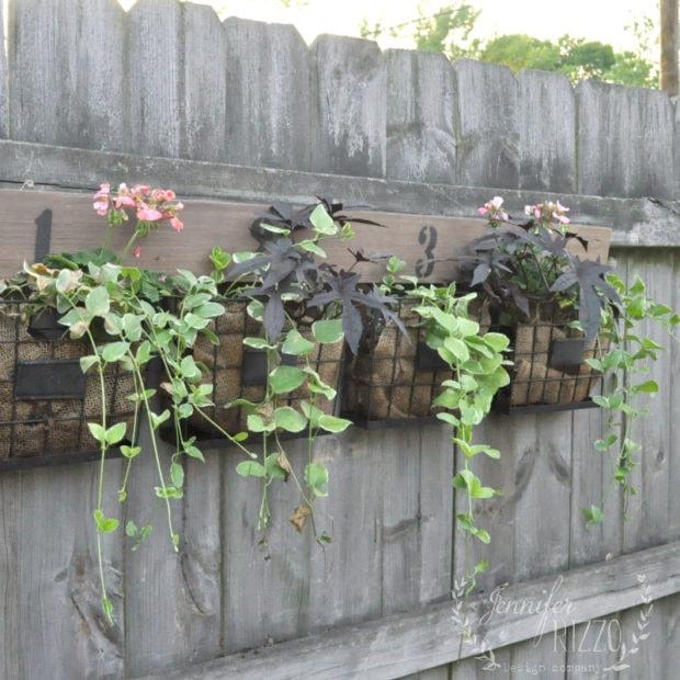 Fun farmhouse fence planter DIY from Jennifer Rizzo