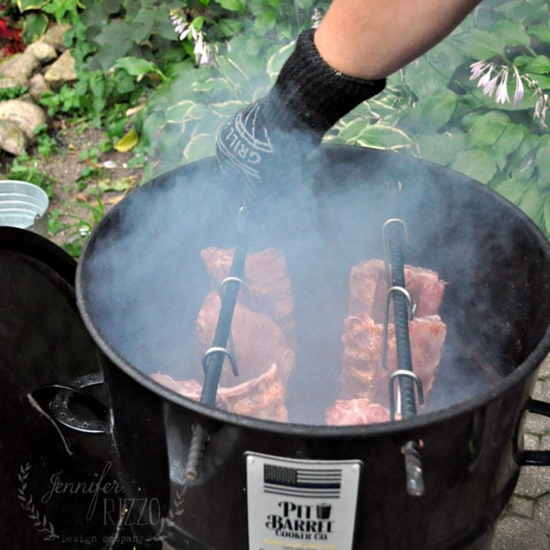 Ribs going into a Pit Barrel Cooker