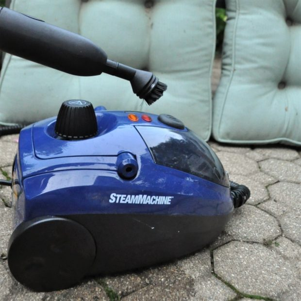 HomeRight Steam Machine with brush attachment for cleaning outdoor tufted cushions