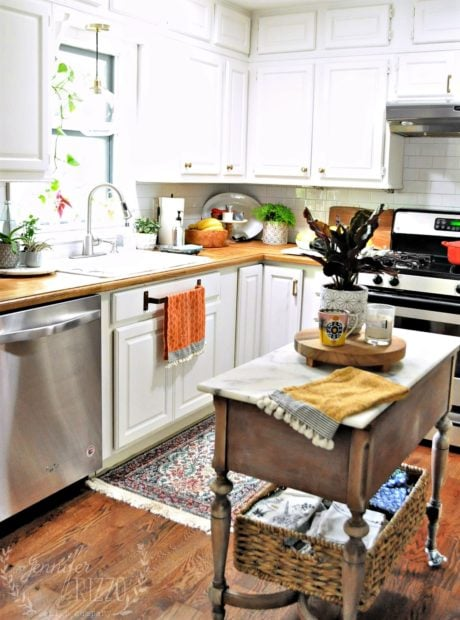Jennifer Rizzo white kitchen islanf kitchen decorating with plants