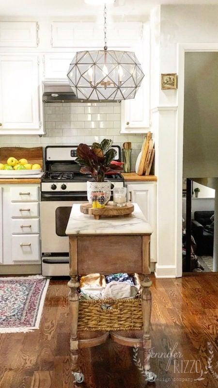 Jennifer Rizzo Brass and glass kitchen chandelier