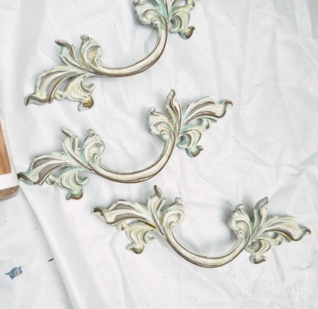 Vintage drawer pulls before painting on a vintage dresser