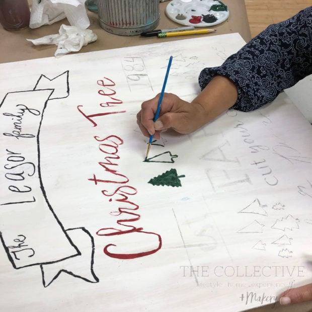 Painting a DIY holiday fresh cut tree farm sign
