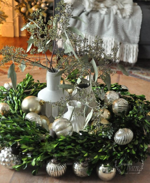 Eucalyptus and boxwood centerpiece with mercury glass ornaments
