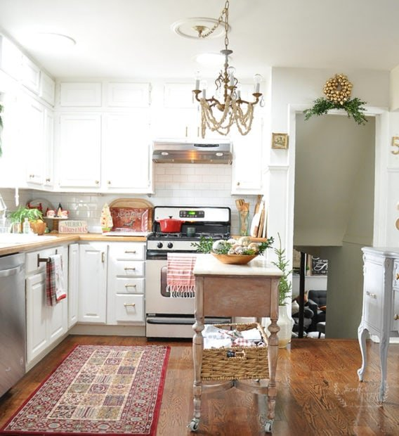 Jennifer Rizzo's white holiday kitchen with vintage chandelier