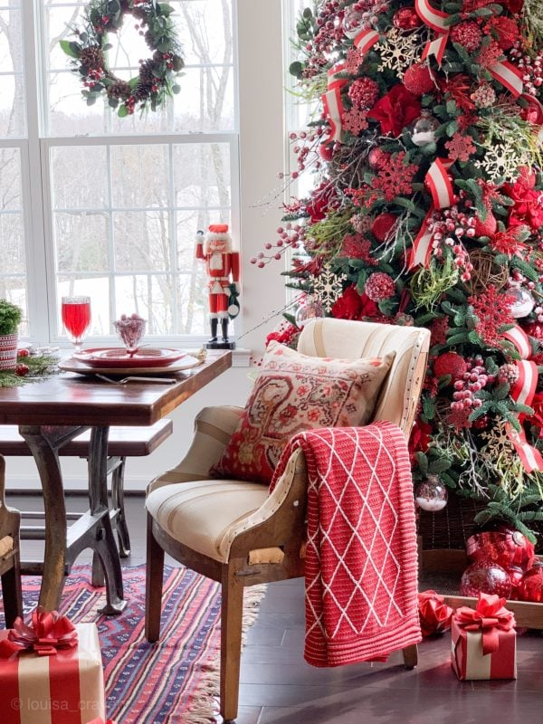 Nutcracker and red tree in sunroom