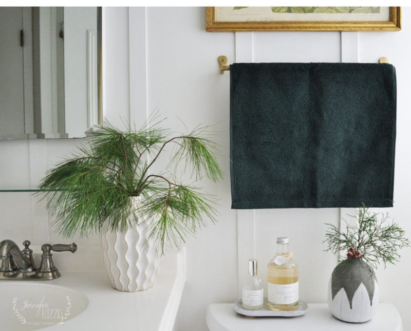 Pine greens in Geometric vase, and on trend dark wall color 2019