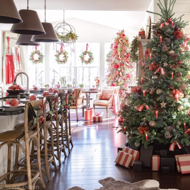 Gorgeous Christmas kitchen with red decor and wreaths