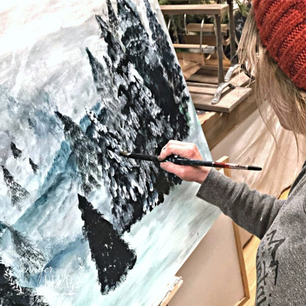 Adding a snow layer in a pine tree acrylic painting