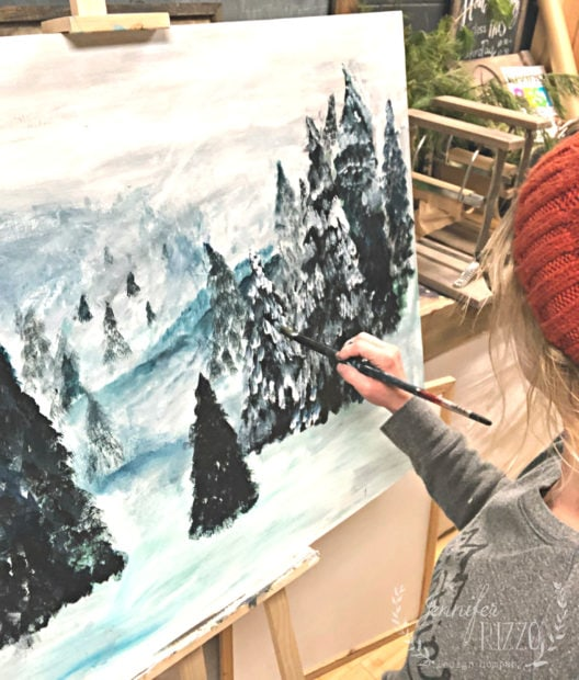 Painting snow on pine trees Jennifer Rizzo