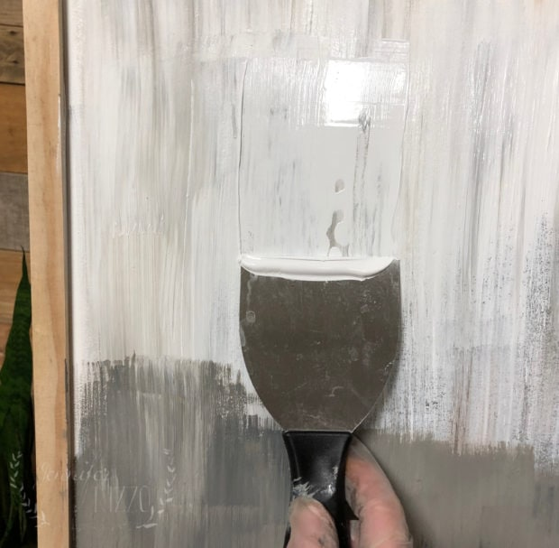 Layer paint with a putty knife from the hardware store. Jennifer Rizzo
