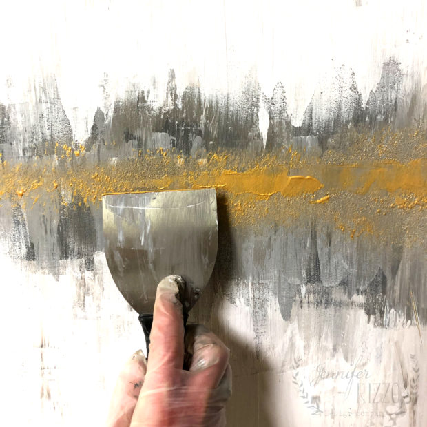 Applying gold paint in a DIY abstract painting tutorial Jennifer Rizzo