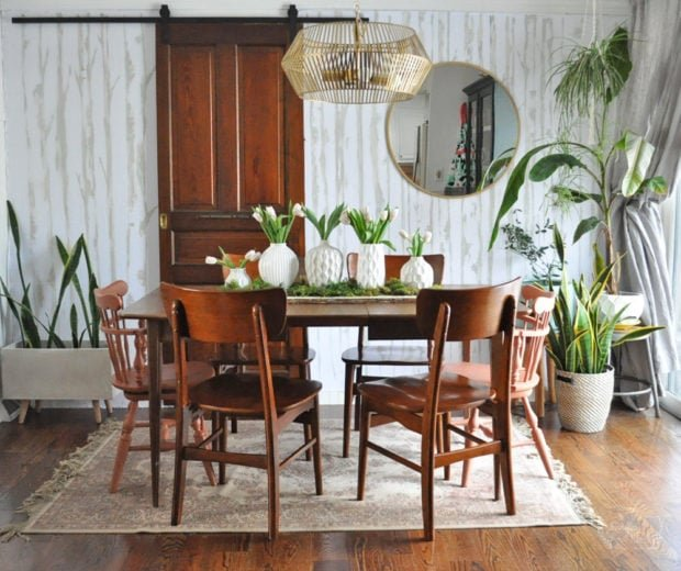 Spring dining room with white vases centerpiece and lots of plants