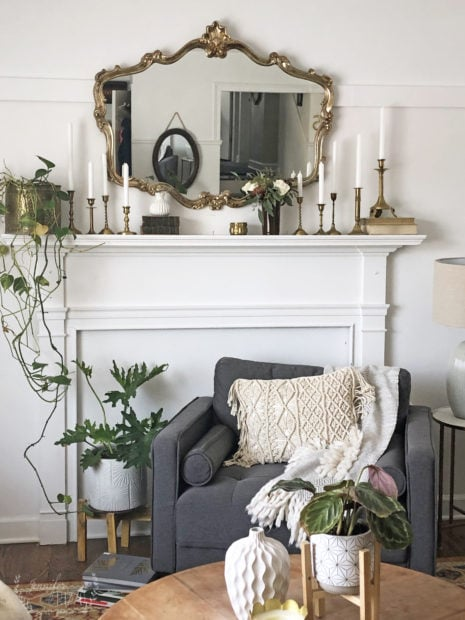Faux fireplace with vintage mirror, and vintage brass candlesticks
