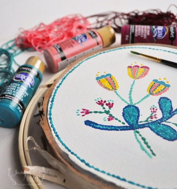 Paint a wood slice to look embroidered