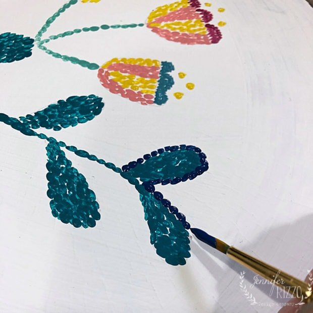 Outlining edge in paint to look like punch needle embroidery