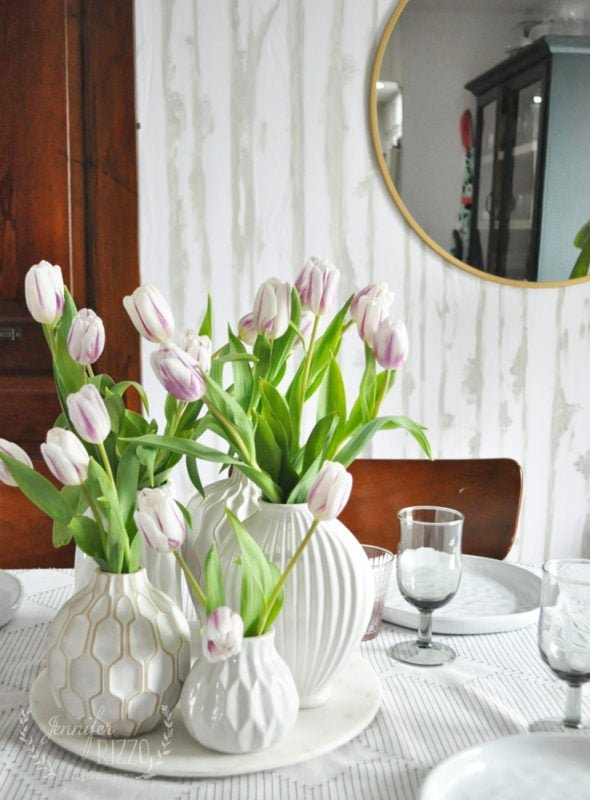 Cluster of tulips in vases as a spring centerpiece Jennifer Rizzo