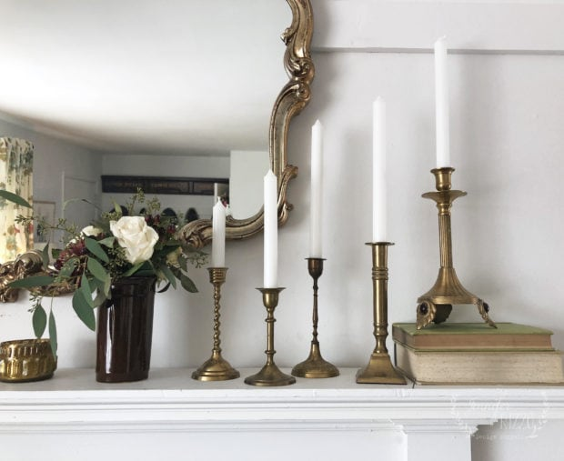 Vintage brass candlesticks on a faux mantel