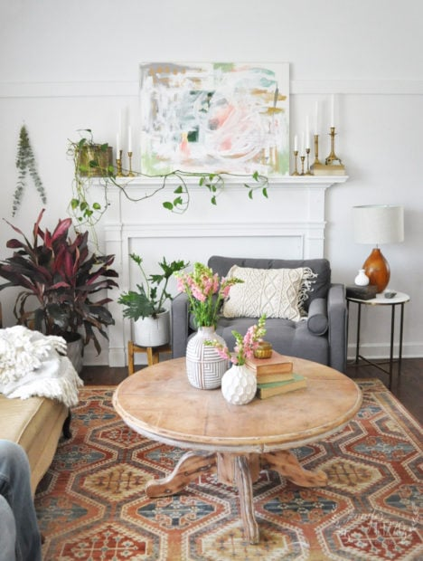 Colorful abstract art and plant in living room Jennifer Rizzo