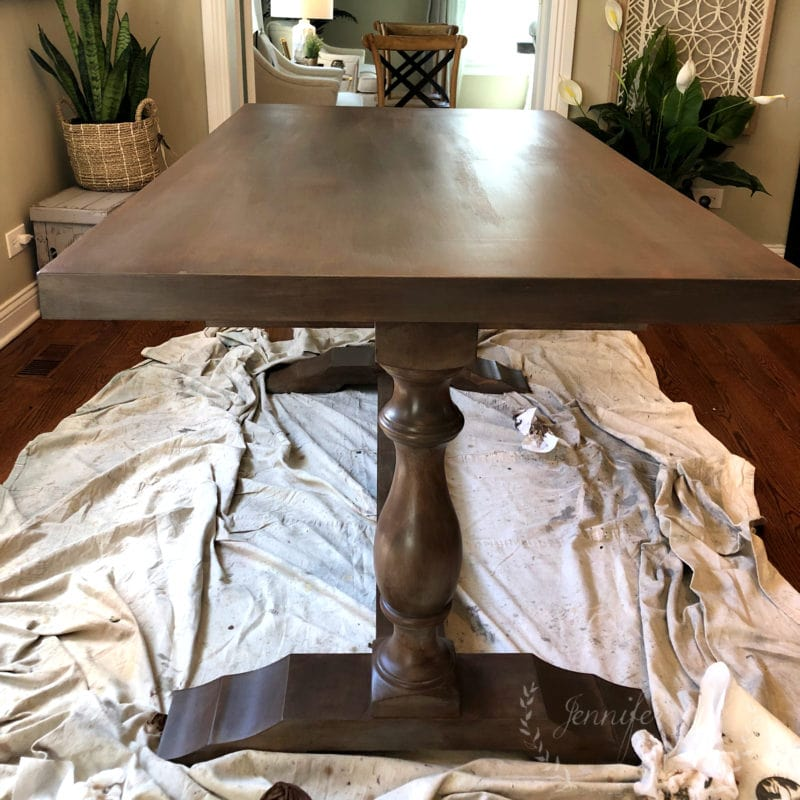 A custom painted table with a brown glaze by Jennifer Rizzo