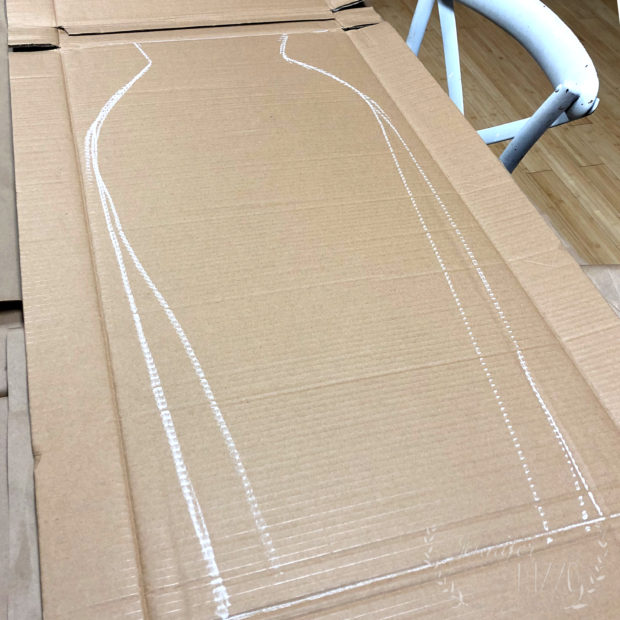 Sketch out vase template on cardboard for window display or DIY pinata