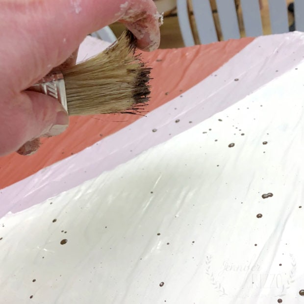 Use an old brush and brown paint to make paint specks on something