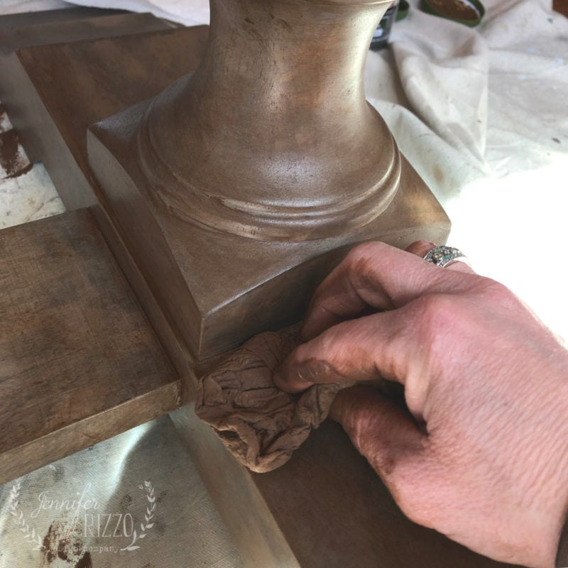 Apply brown paint as a glaze to tone down a table by Jennifer Rizzo