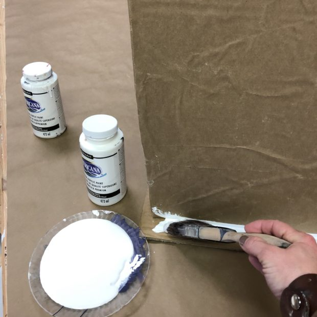 Paint cardboard craft with craft paint