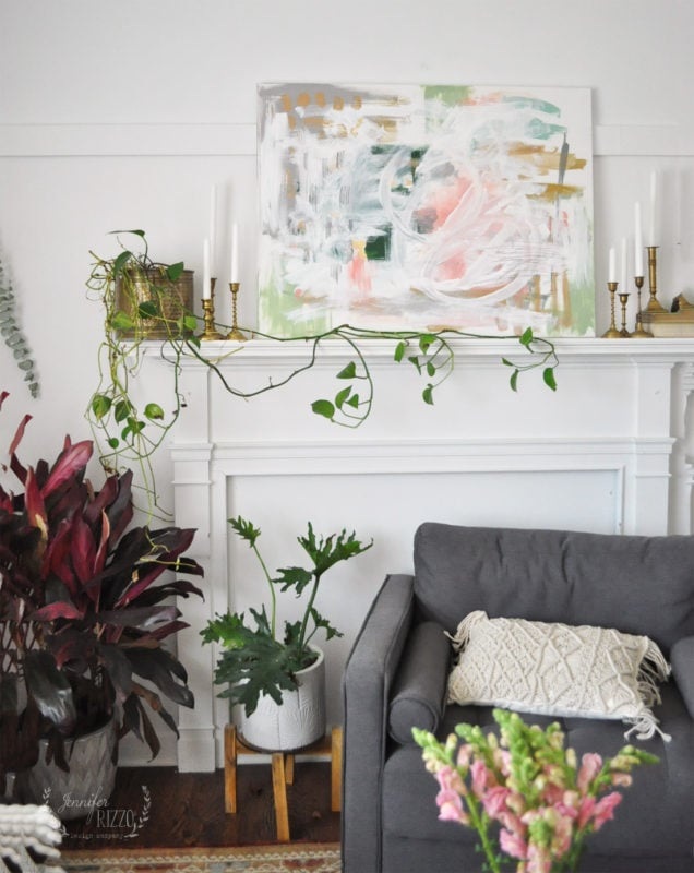 Abstract art above mantel and brass candle sticks