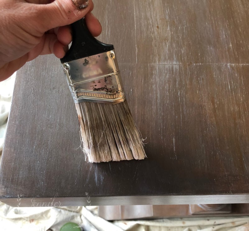 Use an old brush to make white marks to add to a wood look finish by Jennifer Rizzo