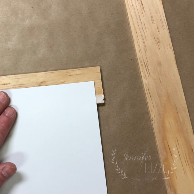 Glue wood to cardstock to make a DIY hanging sign