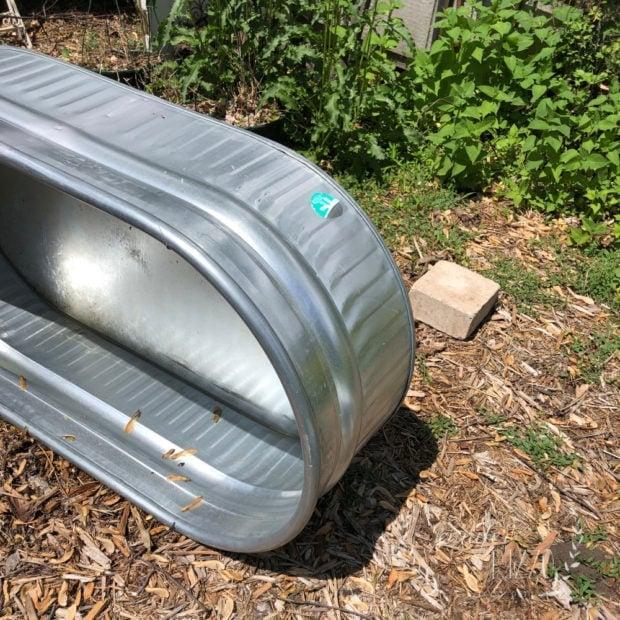 Make a galvanized stock tank into a raised bed garden planter