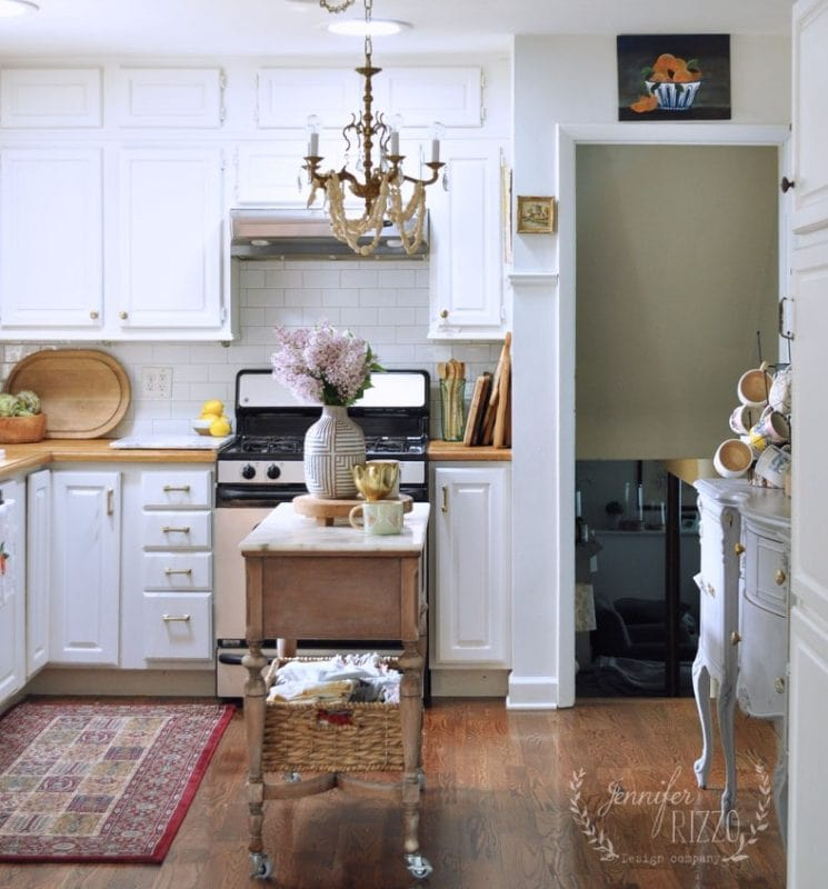 Kitchen white walls and art with wood countertop