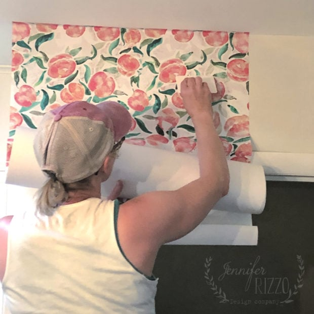 Jennifer Rizzo hanging removable wallpaper from Spoonflower