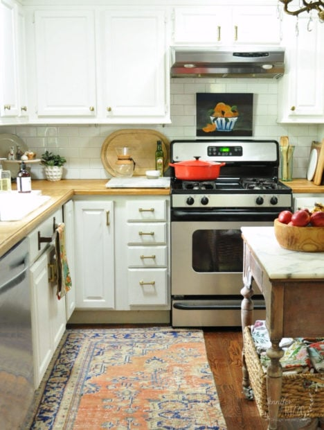 White kitchen with vintage woven rug