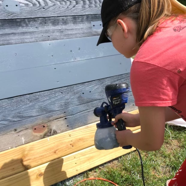 Painting our playset rehab with a paint sprayer