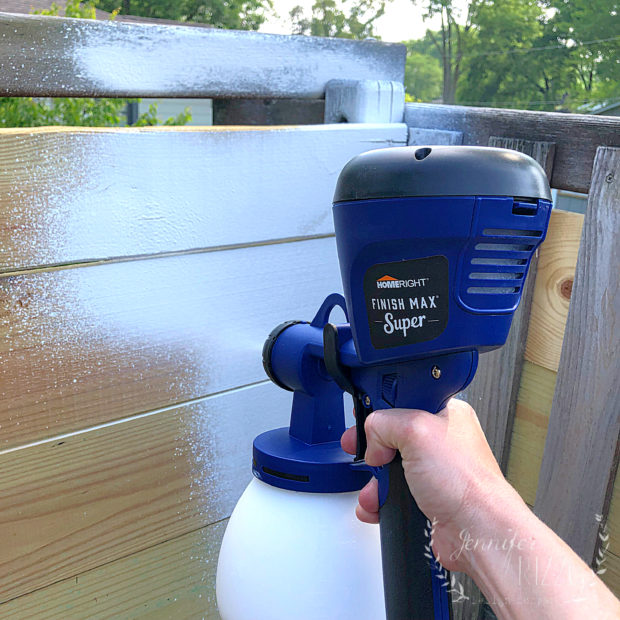 Painting raw lumber with a paint sprayer on our playset rehab