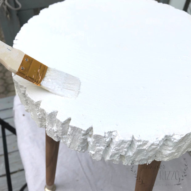 Painting a wood slice white for a DIY plant stand or modern table