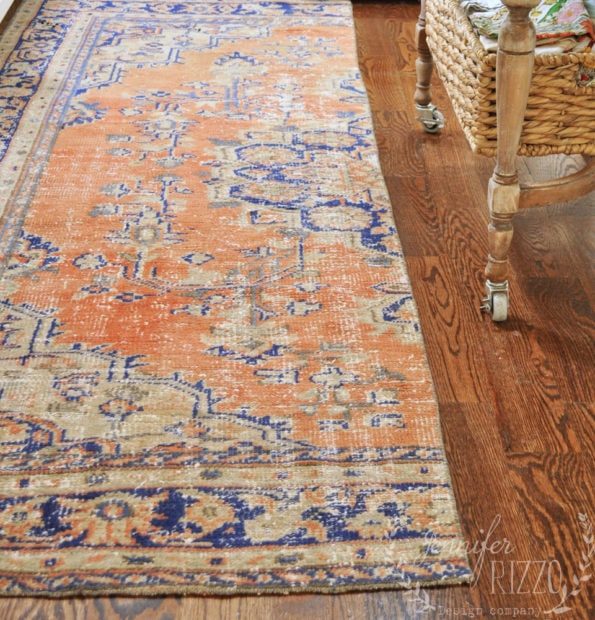Vintage woven rug in the kitchen cut in half to become a runner