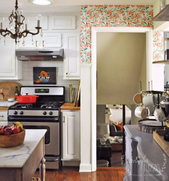 Peach removable wall paper in the kitchen with coral, orange, and pink tones
