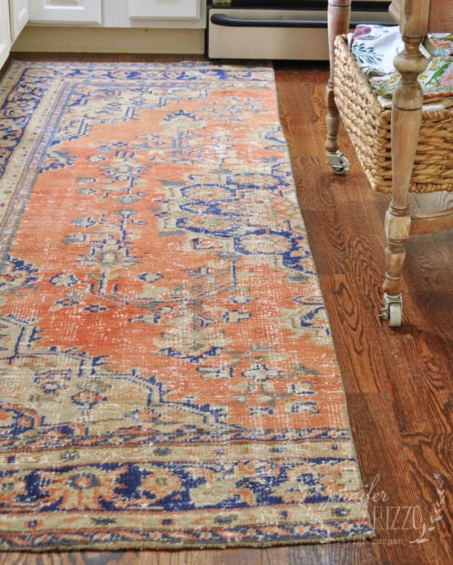 Vintage woven rug cut in half to make a carpet runner