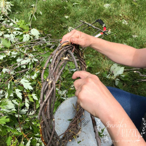 Add the end of a twig tucked into the wreath