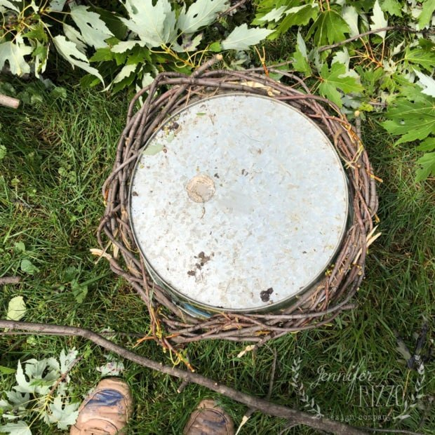Use a metal bucket to keep a DIY wreath round while it dries
