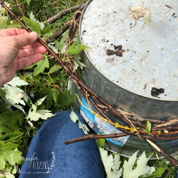 Tuck branches around circle to make a DIY twig wreath