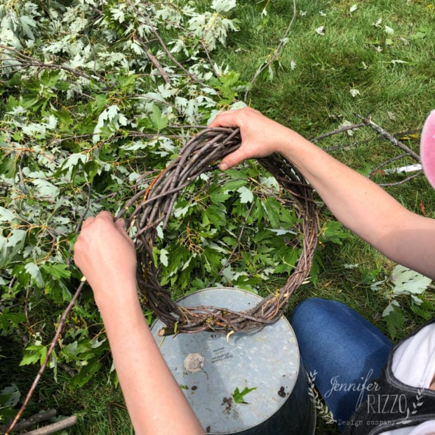 Loop the branch around other branches to make a DIY twig wreath