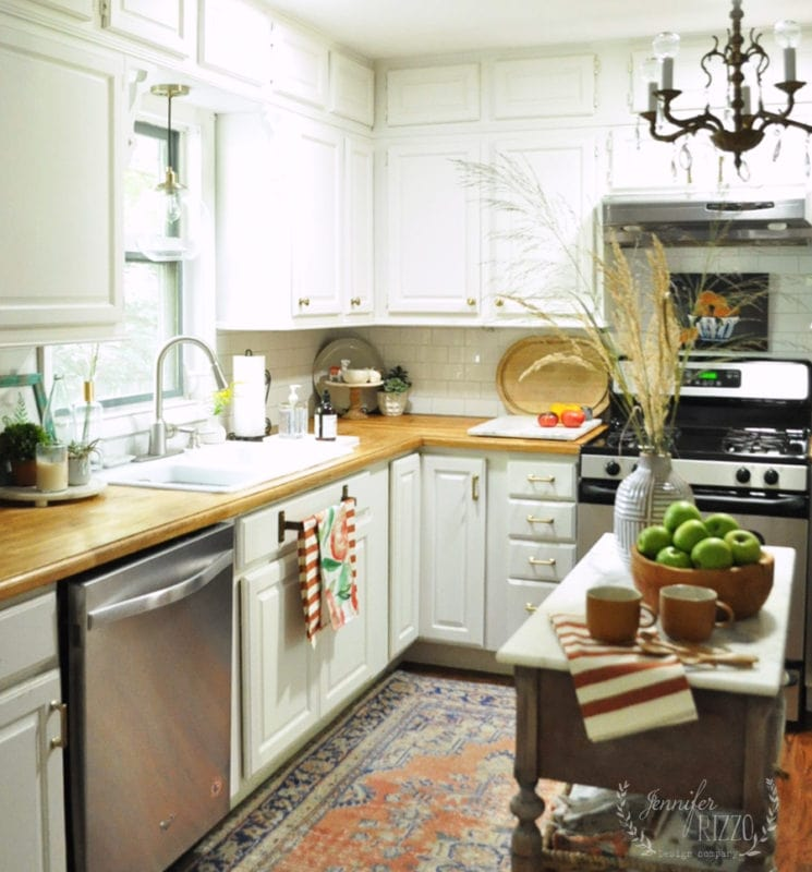 White kitchen with wood countertops and early fall decorating