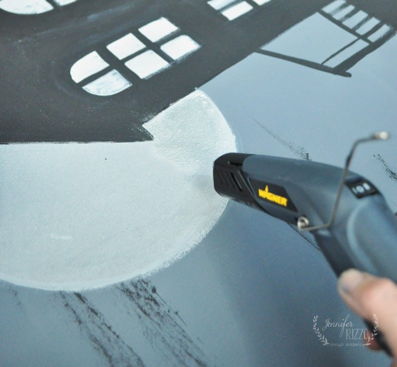Use a heat gun to emboss a canvas