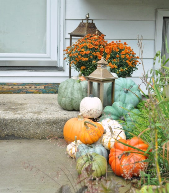 Collection of faux and real pumpkins on front step